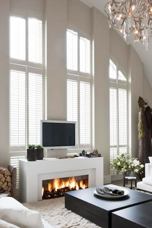 Don't you think this living room looks inviting? Great use of windows! #luxury home #inspiration via @BainUltra