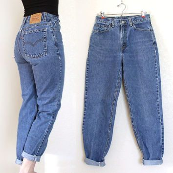 Boyfriend jeans and Levi's... A classic combo.   Lisa