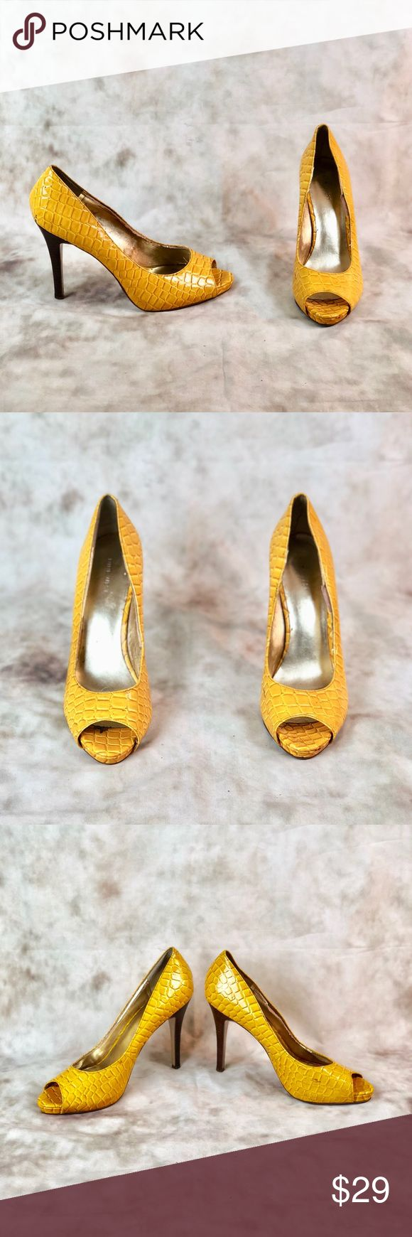 """Nine West Faux Crocodile Yellow Peeptoe Pumps Women's size 11. Beautiful golden Pumps with faux crocodile pattern, wooden 4"""" heels and a peep toe. These shoes are pre owned but in great condition, they do show the usual signs of wear on the sole and a minor scuff. But they're in overall great condition! Nine West Shoes Heels"""