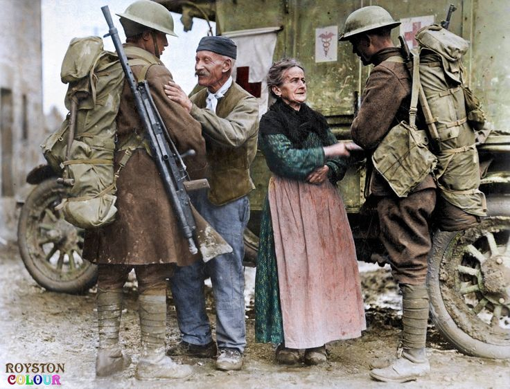 6th November 1918, Brieulles-sur-Bar (Ardennes)    M. and Mme. Baloux welcome two US soldiers from the 308th and 166th Inf. Regts. during the American Forces liberation of their town.  The soldier on the left is carrying the much maligned Chauchat LMG slung over his shoulder, and the ambulance is a 1917 Ford Model T.    Photo Source - US National Archives    Colours by Royston Leonard from the UK