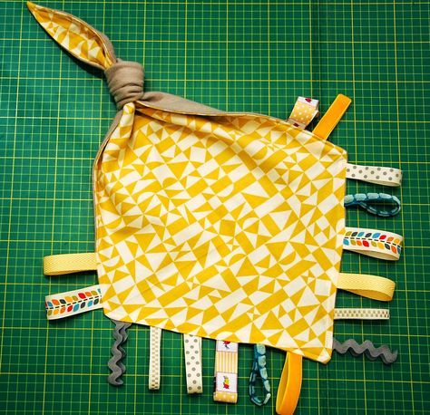 Babies love a taggie - it's something to hold on to, explore, snuggle and play with, all in one. Well, we have gone one step further, a...