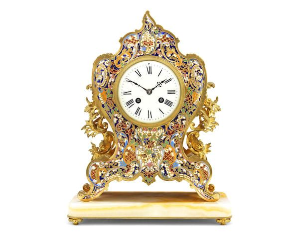 A late 19th century French gilt bronze and champleve enamel mantel clock the movement stamped L.P. JAPY & CIE