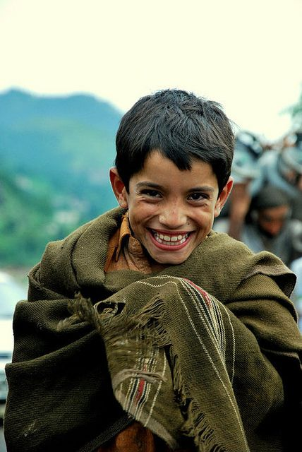 Pakistan Flood 2010 and yet look at the genuine smile on his face. AWESOME!!!