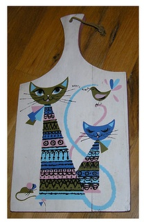 Eames Era Mid Century Cutting Board Mod Cats. I own this, but mine isn't in as good a shape. Someone actually used it as a cutting board. :/