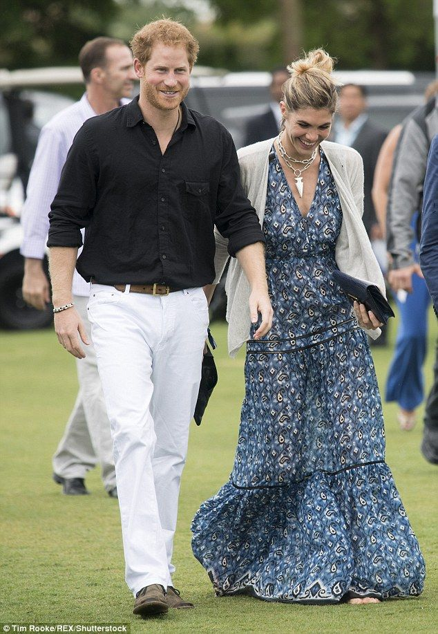 Polo style: Harry look strapping in white slacks and a black polo, as he strolled next to Delfina Blaquier, the model wife of international polo player Nacho Figueras, who was wearing a blue paisley maxi dress