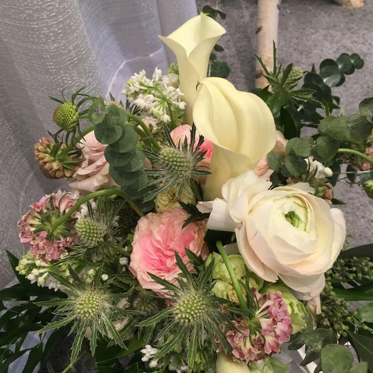 Calla, Garden roses,ranunculus,pink scaboisa, bouvardia and eryngium.