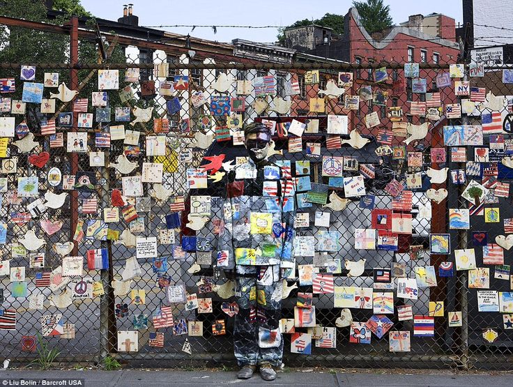 Memorial: In this work called Tiles For America, Liu blends into a wall paying tribute to those who lost their lives on 911
