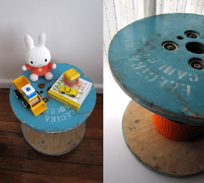 Love the blue paint on this cable spool table with orange cord. Kids spool table.
