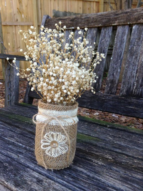 These jars would be just lovely as centerpieces at a rustic, country barn wedding. They look adorable with the dried babies breath. (NOT