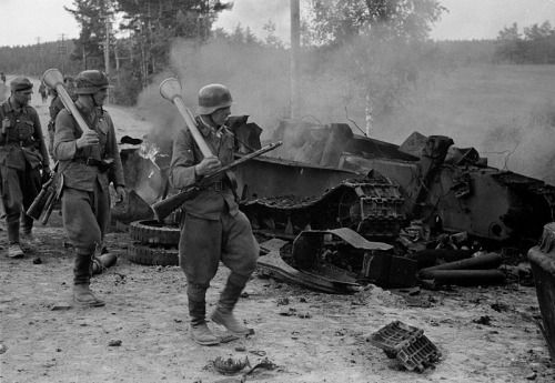 """soldiers-of-war: """" FINLAND. Tali-Ihantala. June 30, 1944. Finnish troops passing by the remains of a destroyed Soviet T-34 during the Battle of Tali-Ihantala (June 25 to July 9, 1944), part of the Finnish-Soviet Continuation War (1941–1944), which..."""