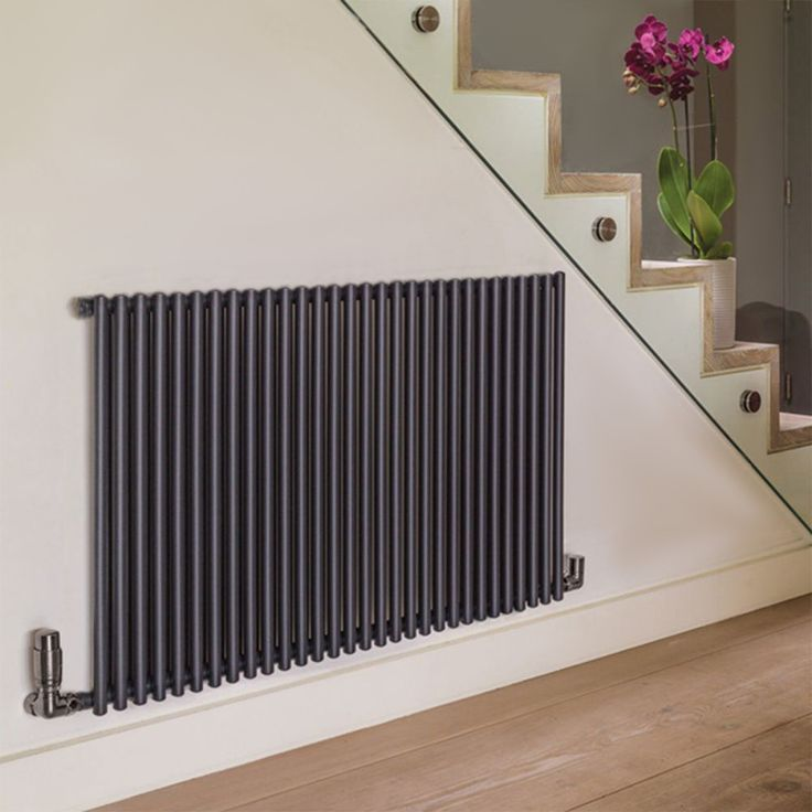 A versatile heating solution for contemporary homes. The Bisque Trubi boats a clean white finish that will blend in with white walls and contrast on darker shades, meaning it can enhance your interior or be the focal point. #hallwayradiators