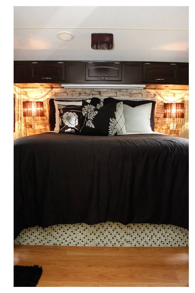 Bedroom with custom upholstered headboard and stone wallpaper along with custom glass mosaic tiled platform