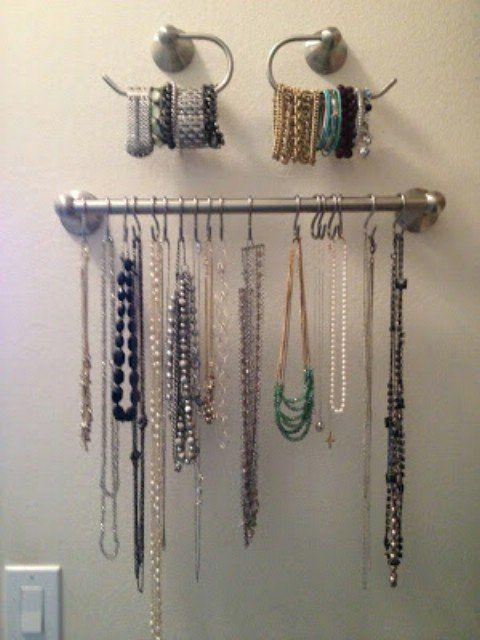 Closet Jewelry Organizer A towel rack or two, some S-rings and toilet paper holders will give you plenty of behind the door storage for your jewelry. Just attach these items to the door, or any spare wall space you have in the closet, and you can put bracelets and necklaces in the closet and out of the way. Hanging baskets are another great organizing trick for jewelry and are really cheap, too. Source – Overthrowmartha