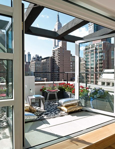 loft in NYC... This is truly an amazing view of the buildings! Like a little sunroom :)