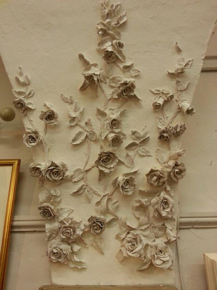 Plaster flowers on the studio wall