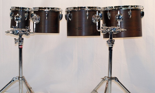 Earth Brown Concert Toms:  The top 4 drums out of the complete set of 8 concert toms, finished in Earth Brown.  Each pair of drums include a Gibraltar 7700Q stand.  Multiple set-ups are made easy by accessorizing with these sturdy stands. 6x6, 7x8, 8x10, 9x12; plied maple; semi-gloss wax. To see more pix, and search our entire TreeHouse archive for your favorite specs, visit our photo gallery:http://www.flickr.com/photos/treehousedrums/collections/