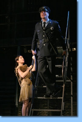 Theatre 20 Founding Artist David Keeley as Officer Lockstock (right) with Jennifer Waiser as Little Sally in CanStage's production of URINETOWN. Theatre20.com