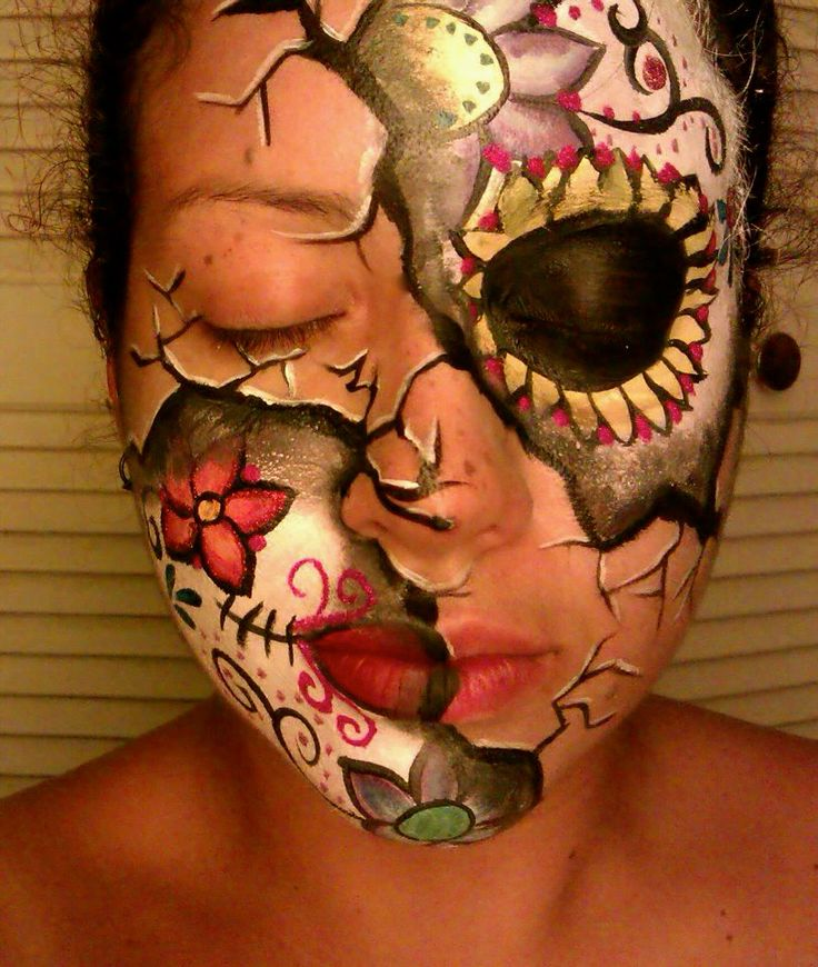 Love the cracks with the sugar skull peeking through