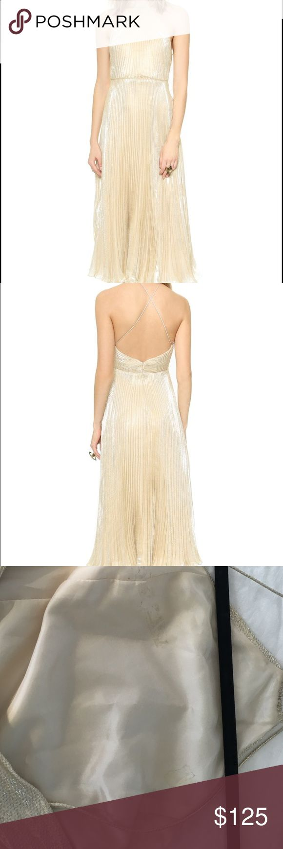 Jill Jill Stuart gold halter gown Sz 6 Worn once to wedding! Excellent condition except for marks on inside slip from fashion tape. Shown in pic. Crisp pleats and patterned lamé create an optical effect on a glamorous Jill Jill Stuart halter gown. Spaghetti straps crisscross the open back, and a seam defines the waist. Hidden zip. Lined.  Fabric: Lamé. Shell: 61% silk/39% metallic. Lining: 100% polyester. Dry clean. Imported, China.  Measurements Length: 48.5in / 123cm, from shoulder Jill…