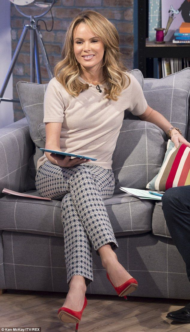Daytime glam: Amanda Holden cut a chic and stylish figure as she presented on This Morning...