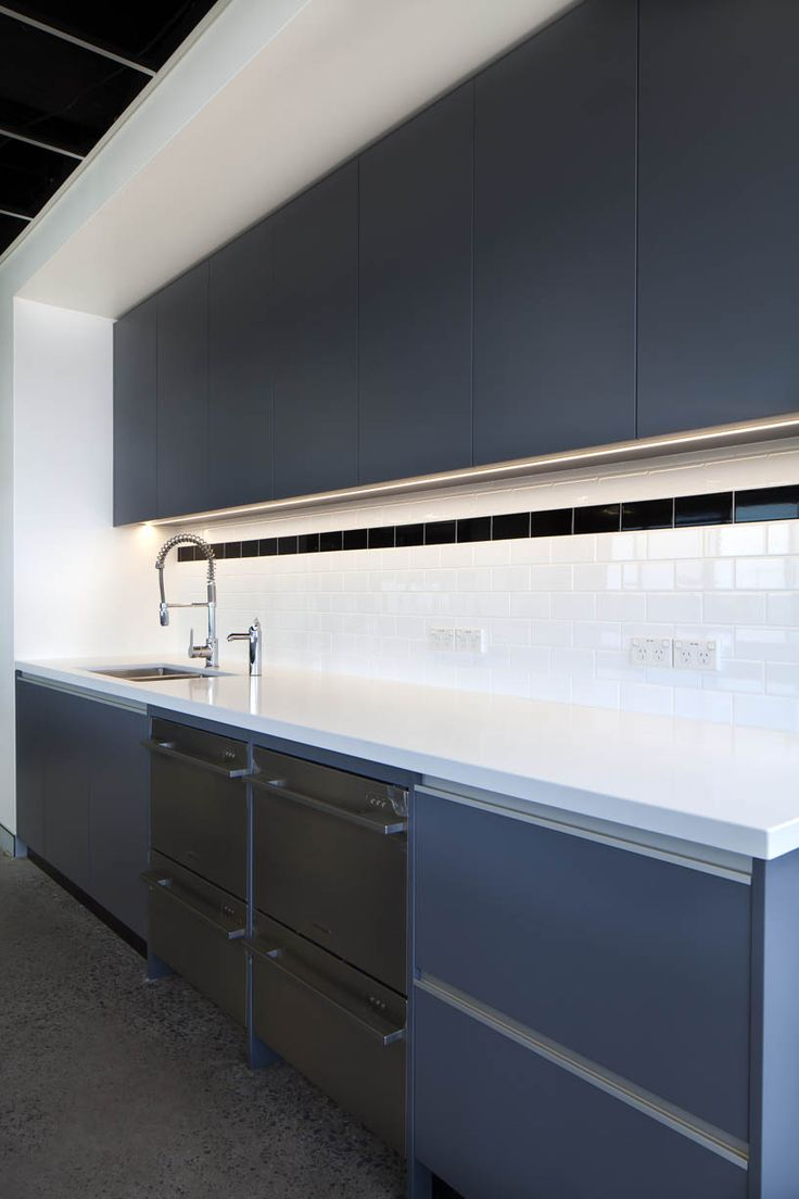 The Bold Collective | Traffik | Kitchen: subway tiles, charcoal joinery, office kitchen breakout, monochrome, polished concrete, stainless steel, black ceiling, open ceiling grid