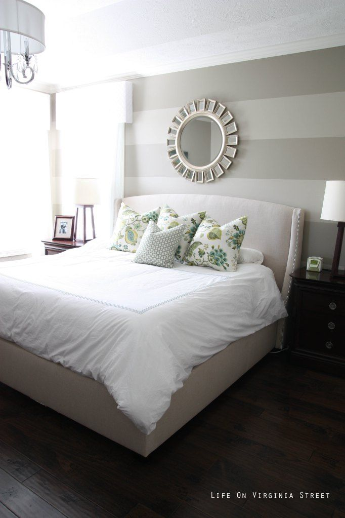 I love how this mirror looks above this bed.  It add such a luxurious look to the room.