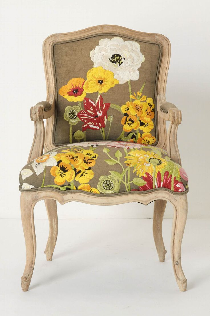 I think I might just buy a cheap chair and mimic this.  Love the choice of the flowers against that color fabric