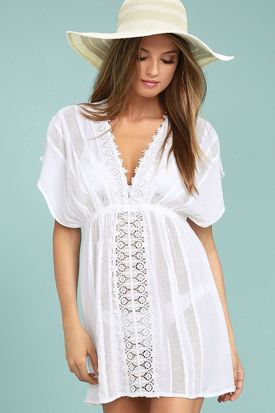 The O'Neill Kiala White Lace Cover-Up is a beach day essential! Stripes of pierced embroidery and crochet lace accent this breezy, woven swim cover-up with a sexy plunging neckline, short dolman sleeves. Elasticized waist tops a sheath skirt. Metal logo tag at back.
