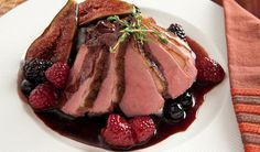 Serve something new (and super impressive) to your holiday guests. Seared Duck Breast with Red Wine and Berry Sauce