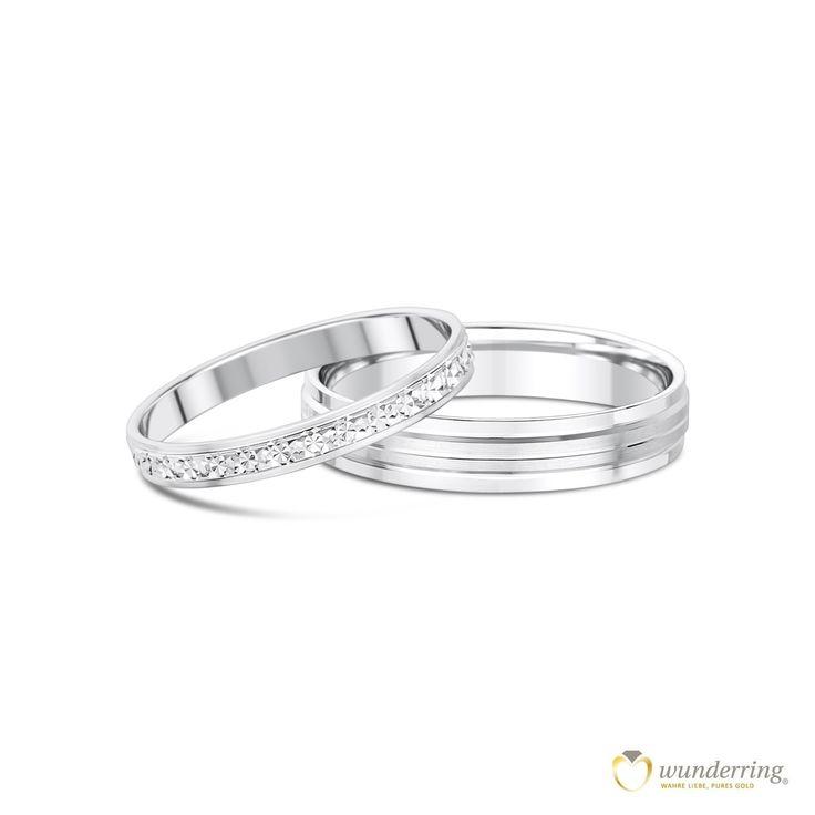 Die Eheringe Qalito sind eine Kombination aus einem feinen Damenring mit Diamantierung und einem breiten Herrenring im modernen Design. Weißgold, Palladium oder Platin. #Trauringe #Hochzeit