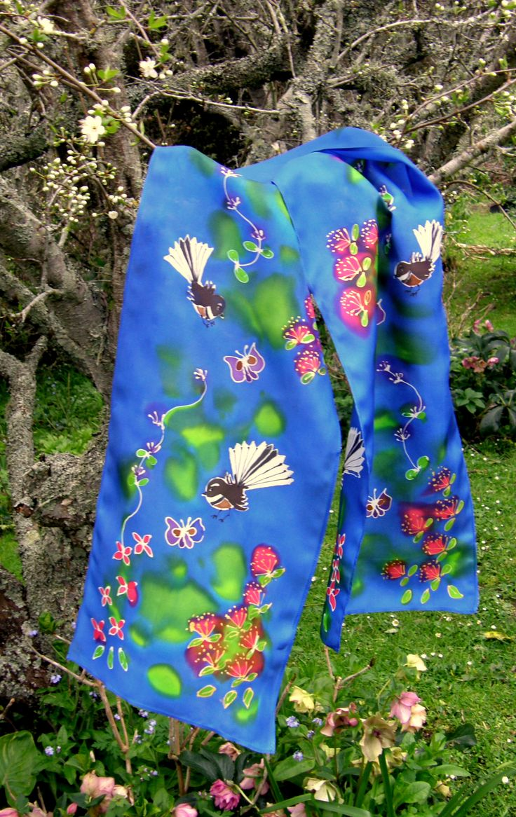 """NZ Native Birds on Hand Painted Silk Scarves www.satherleysilks.co.nz The """"Fantail Garden"""" scarf in the garden!! A lively dance of our lovely Piwakawaka amongst Pohutukawa flowers and others with butterflies, it's all there!! on the plum trees just coming into blossom with the Hellebores below that have been such a joy over the winter. At Silverdale market Sat 8 - 1pm."""