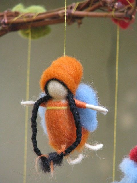 A rainbow fairies mobile needle felted by Made4uByMagic on Etsy, $82.00