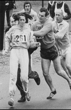 The first woman to run the Boston marathon, and the men trying to pull her off the course.