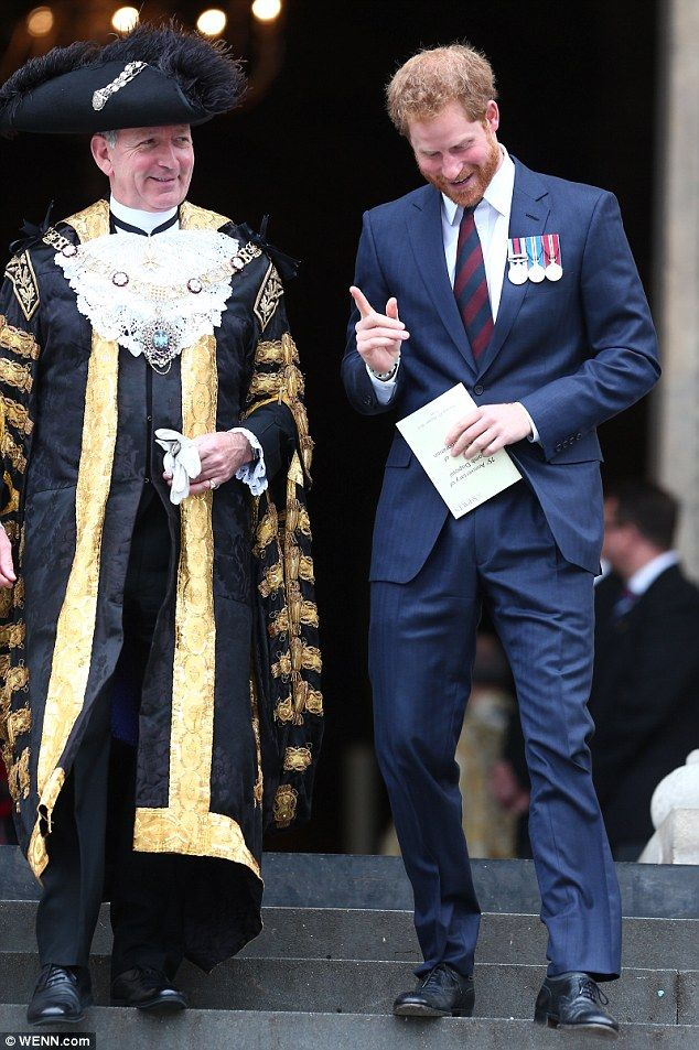 Prince Harry, pictured right, and the Lord Mayor of London, Alan Yarrow, left, appear to share a joke