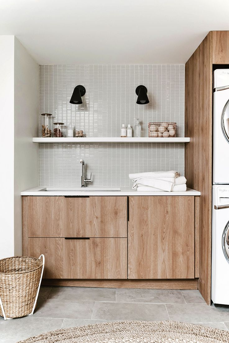 Designer Anna Smith of Annabode + Co. reveals her own DIY renovation of her modern laundry room on a budget - using IKEA cabinetry and Semihandmade fronts.
