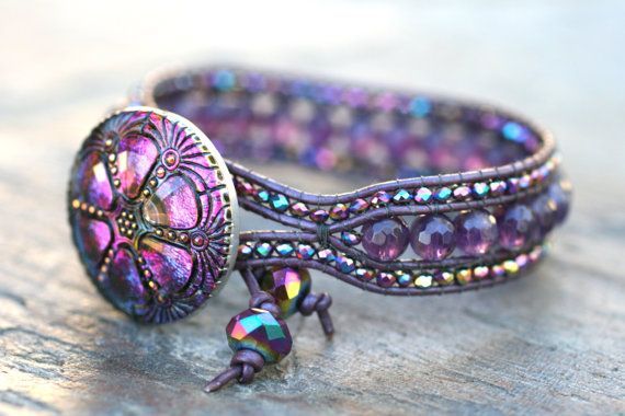 This would be ideal for Nicole...she LOVES purple! Amethyst Gemstone and Purple AB Crystal Leather Wrap by MindyG - Genuine amethyst gemstones are hand woven with tiny purple AB sparkly crystals. Metallic purple leather cord combined with a beautiful large Czech glass button closure. Bracelet size is 7.25 in. This is stunning!!!
