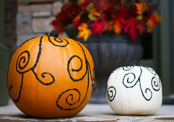 Glittered pumpkins using Elmer's glue, a Sharpie, glitter and a paint brush. Easy-peasy, and so cute!