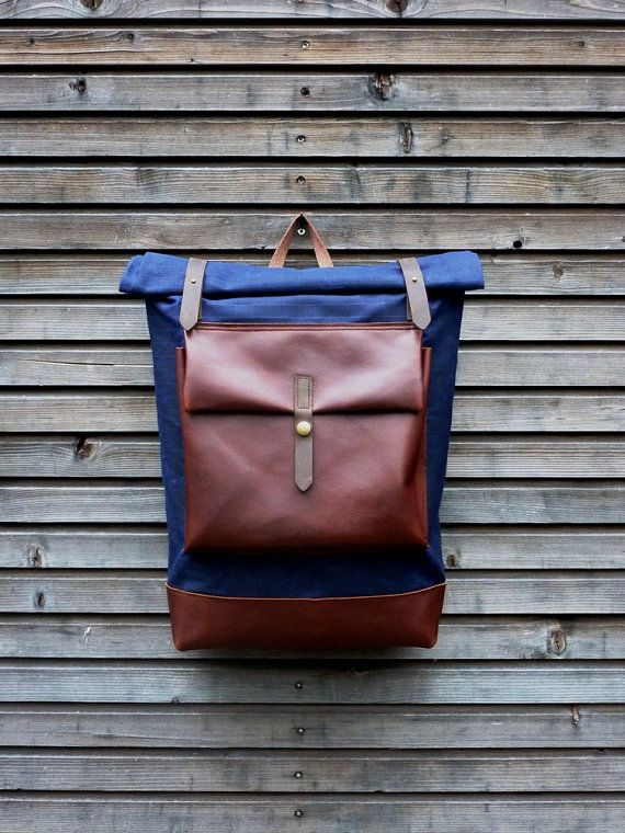 Waxed canvas rucksack/backpack with roll up top and oiled leather bottom