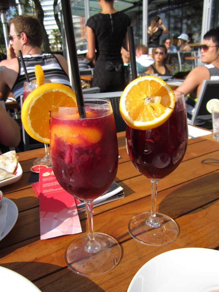 A recipe for Cactus Club's Sangria made with muddled raspberries and strawberries, 2 ounces of California Red Zinfandel, 1/2 ounce of Apricot Brandy, Sprite, and a splash of Bellini.
