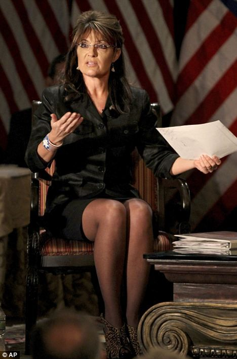 Flying the flag: Former Alaska Governor Sarah Palin - complete with short skirt and stars and stripes wristband - answers questions at a lunch meeting in Long Island last week