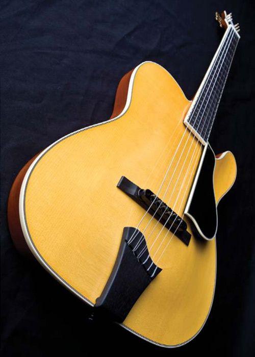 Model-T Jazz Nylon semi-hollowbody with spruce top, mahogany body, Nittono's custom preamp and custom neck shape requested by Santana.