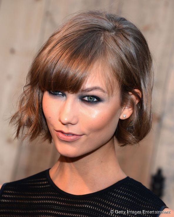 Karlie Kloss smokey eye make up adds sex appeal to her hairstyle at Target FEED USA Collaboration launch event on June 19th, 2013.