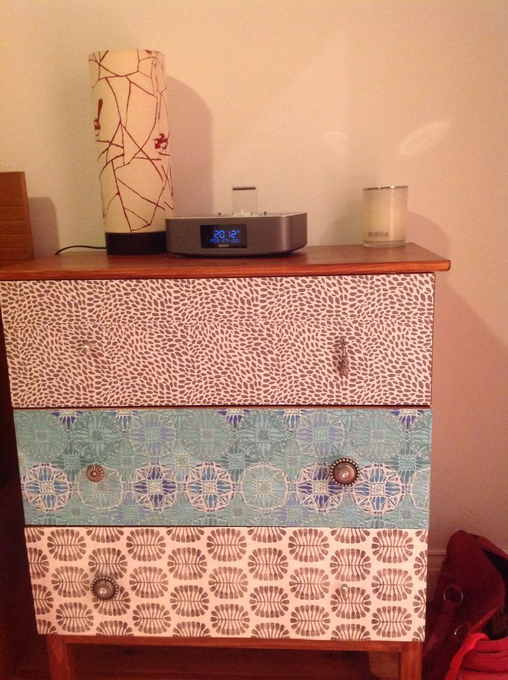 IKEA hack. Tarva chest of drawers stained, wallpaper front and bespoke handles.