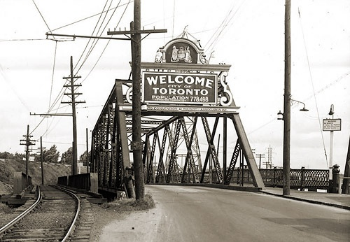 I think this is the queen st east bridge to Leslieville back when Toronto had a population of 778,498.