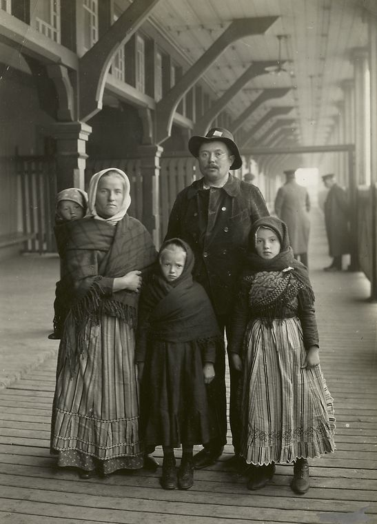 Germans looking scared and lost at Ellis Island. Looks like a family that just arrived. They look out of their confort zone.