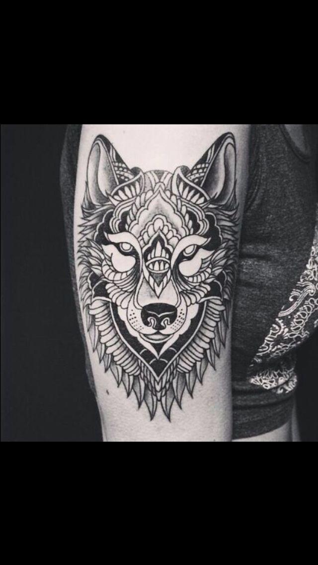 Wolf tattoo. Mandala style.
