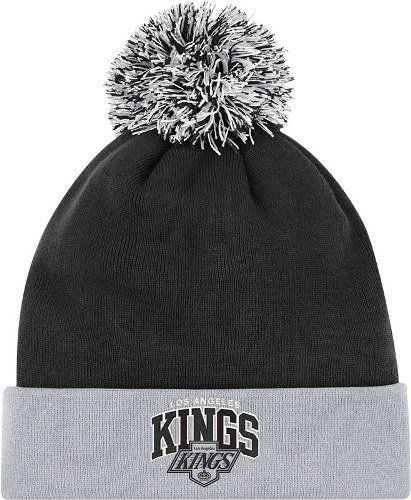 """Los Angeles Kings Mitchell & Ness """"Arched Logo"""" Vintage Cuffed Premium Knit Hat w/ Pom by Mitchell & Ness. Save 25 Off!. $17.95. Protect your head and ears in the cold, blustery weather by wearing this stylish retro cuffed knit cap from Mitchell and Ness. Features cotton yarn embroidered vintage team logo, 100% acrylic, and Mitchell and Ness back embroidery. Officially licensed."""