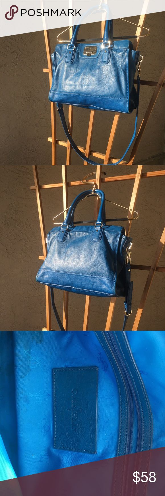 Cole haan royal blue shoulder work bag Bright blue purse, can be used as a shoulder bag or held by its short straps as a tote. Would be great as a briefcase for all you hardworking babes or just as a fun pop to a neutral outfit.  There is a bit of a stain on the inside which is only visible if opened and slight wear on the leather also on inside top bit. Both noted in picture. Otherwise outside looks great and is in good condition. Cole Haan Bags Shoulder Bags