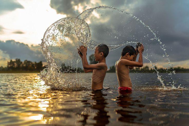 Thai boys indulge in the river near home by Jakkree Thampitakkul on 500px