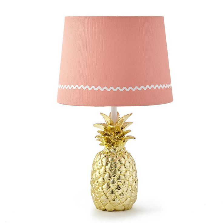 The Levtex Baby Oasis Lamp Base and Shade is a Babies R Us Exclusive! Featuring a playful gold pineapple base with a metallic finish, the lamp shade is made of a pink canvas material and features a white rick-rack pattern along the border. This lamp will brighten up the nursery while adding a decorative accent to the room. The Oasis Lamp Base and Shade coordinates perfectly with the Levtex Baby Oasis Bedding Collection, sold separately.<br><br>The Levtex Baby Oasis Lamp Base and S...